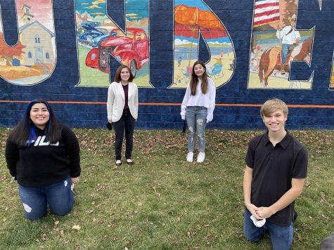 "In a heated tent outside of Area Coffee in Mundelein, senior Rosy Castro, freshman Kai Ackerman, freshman Gianna Feather and junior Eli Walter film ""Something In Common,"" a play by Robin Pond, directed by Castro. This play, along with 11 others, will stream on Dec. 12 and 13 for virtual audiences."