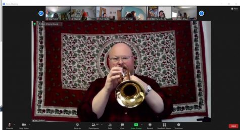"While performing the group's music, Band Director Jerald Shelato plays his trumpet during 5th period on Zoom, unmuted, for the Honors Wind Ensemble musicians to play along with at home. ""Students, you may or may not believe this, but to whatever degree you find online band to be cold, lacking, without spark, etc., so do I,"" Shelato said. ""I want us to get back to regular in-person band as soon as we can safely do it."""