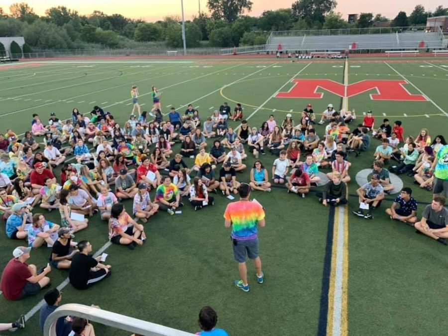 After+the+first+day+of+band+camp%2C+Band+Director+Andy+Sturgeon+reviews+the+day+with+the+Marching+Mustangs+as+well+as+gives+announcements+for+events+to+come.+Sturgeon+said%2C+%E2%80%9CThis+daily+routine+is+one+aspect+that+has+been+fun+to+be+able+to+do+in+person+again+this+season.%E2%80%9D